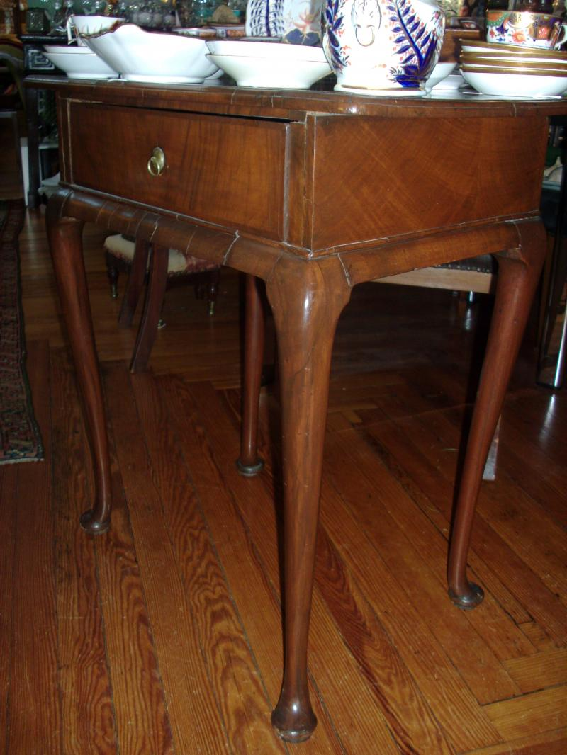 Mahogany side table with queen ann pad feet and single drawer